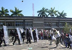 Confrontation between protesters and riot police during a Belizian