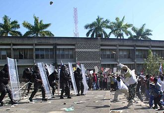 Improvised weapon - Rocks being thrown in 2005 Belize unrest