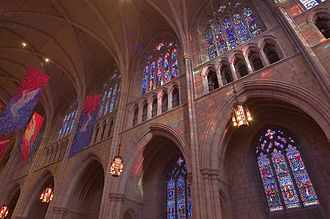 Princeton University Chapel - The interior south wall of the nave. James Madison is shown in brown and royal blue in the rightmost panel of the upper right window.