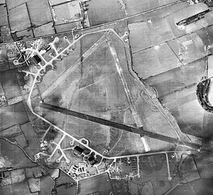 RAF Cheddington - Aerial photograph of RAF Cheddington looking north, the bomb dump at the top, the control tower and technical site are at the bottom, 3 March 1944. Note the many Consolidated B-24 Liberator bombers of the Combat Crew Replacement Center parked on the loop hardstands.