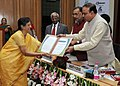 Radha Mohan Singh and the Union Minister for Chemicals & Fertilizers and Parliamentary Affairs, Shri Ananth Kumar presenting the certificate.jpg