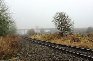 Wilkesboro, Oregon - Railroad crossing of the Port of Tillamook Bay Railroad at Wilkesboro Road with Oregon 6 in the distance