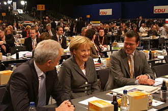 Peter Ramsauer - Ramsauer and Merkel with Karl-Theodor zu Guttenberg at a CDU party conference, 2008
