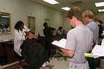 Recruits from Flights 569 and 570, 3703rd Basic Military Training Squadron, get their first military haircuts DF-SC-90-03927.jpg