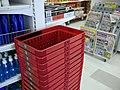Red shopping baskets in market 20180227.jpg