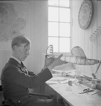 James Harry Lacey - Lacey works on a model aeroplane in No 501 Squadron's dispersal hut at Colerne on 30 May 1941