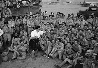 Will Fyffe - Fyffe entertains men of the RAF Regiment in the open air at Hammamet, Tunisia, during his tour of North Africa.