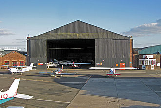 City Airport & Heliport - A 2015 view of the main hangar which was completed during January 1930