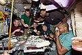 STS 129 Expedition 21 crew members having dinner in Node 1.jpg