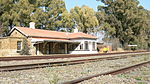 The station building is a long building made of sandstone. It has a stand-up roof made of metal tile This railway station building of sandstone was completed shortly before the Anglo-Boer War (1899-1902). It is one of only a few station buildings erected during the Republican period and forms an important link with the Orange Free State railway system of Type of site: Railway Station Previous use: Other: Sannaspos Battlefield. This railway station building of sandstone was completed shortly before the Anglo-Boer War (1899-1902). It is one of only a few station buildings erected during the Republican period and forms an important link with the Orange Free State railway system of