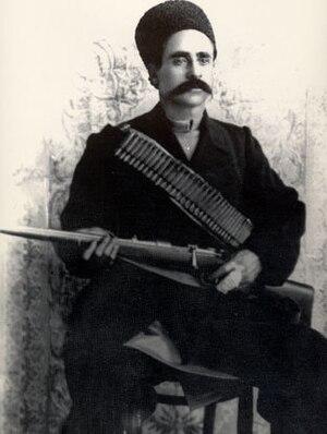 Sattar Khan - Portrait photograph of Sattar Khan with his rifle.