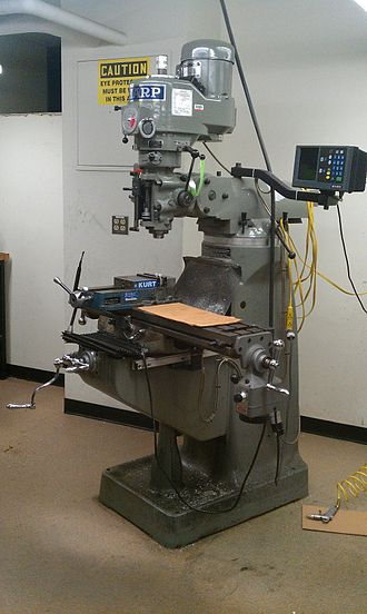 Bridgeport (machine tool brand) - A full view of a Sharp Machinery 3 axis vertical mill. An example of a Bridgeport clone. The head is mounted on the ram by joints that allow it to swivel in two directions. The ram can slide back and forth on the turret, which can swivel on the column. The table sits on the knee, and it can move horizontally in the X and Y axes. The knee rides up and down the column (one form of Z-axis movement), and the head contains a quill in which the spindle can slide up and down (another form of Z-axis movement or, when the head is swiveled, an additional axis).