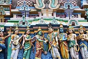 Nataraja Temple, Chidambaram - The artwork on gopuram showing Parvati-Shiva kalyansundram wedding legend. Near the newly weds are Saraswati, Lakshmi, Vishnu and others.