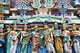 Nataraja Temple, Chidambaram - The artwork on gopuram showing Parvati-Shiva kalyansundram wedding legend. Near the newly weds are Saraswati, Lakshmi, Vishnu and others.