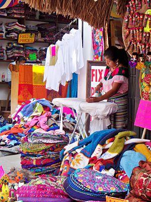 Shopkeeper - A shopkeeper in Cancún, Quintana Roo, Mexico