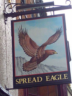 Birds in culture - The Spread Eagle pub sign: the pub is named after a heraldic symbol.