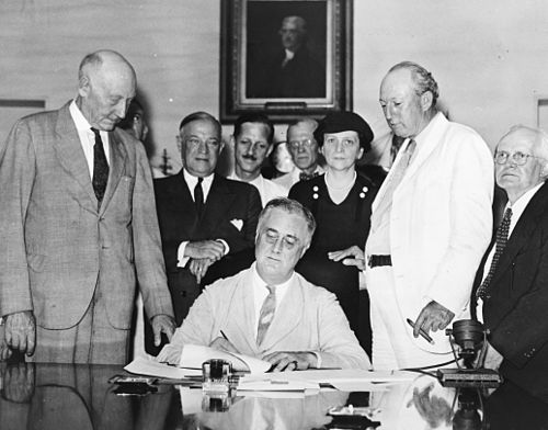 President Roosevelt signs the Social Security Act, August 14, 1935. Signing Of The Social Security Act.jpg
