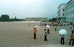 A large square in the center of Sinŭiju in August 2012, with a statue of Kim Il-sung.