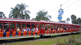 Busch Gardens Tampa - Train cars from the Serengeti Railway in the foreground with the Skyride in the background
