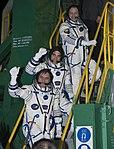 Soyuz TMA-08M crew members wave farewell.jpg