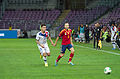 Spain - Chile - 10-09-2013 - Geneva - Eduardo Vargas and Andres Iniesta.jpg