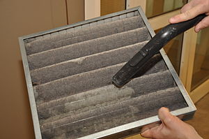 Indoor air quality - A common air filter, being cleaned with a vacuum cleaner