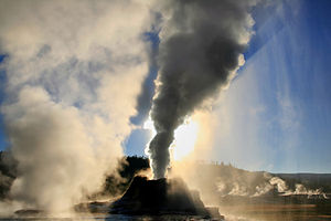 Shadow - Steam phase eruption of Castle Geyser in Yellowstone National Park casts a shadow on its own steam. Crepuscular rays are also visible.