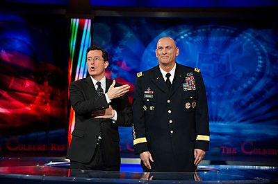 Stephen Colbert asks the crowd for an standing ovation in honor of Army Chief of Staff Gen. Raymond T. Odierno after the recording of an interview for the Colbert Report in New York City, New York, on December 14, 2011.jpg