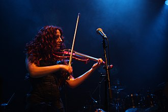 Marcela Bovio - Bovio playing violin with Stream of Passion in 2009.