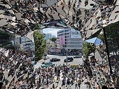 Street crowd reflecting in the polyhedral mirrors of the station Tokyu Plaza Omotesando, Harajuku, Tokyo, Japan.jpg