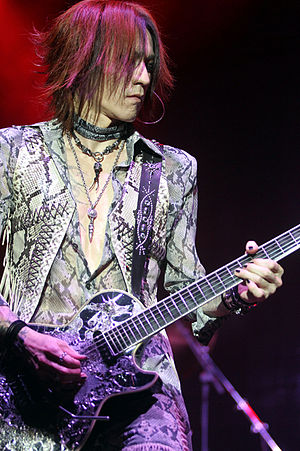 Sugizo -  Sugizo performing with X Japan in São Paulo, Brazil 2011.