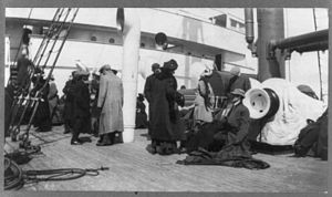 Survivors from TITANIC aboard rescue ship, unidentified group on deck.jpg