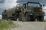 Tactial Supply Wing of the Royal Air Force get a Fuel Truck into postion to await incoming Helicopters for refueling during Exercise Swift Responce. MOD 45160066.jpg