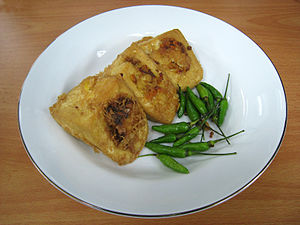 Tahu goreng - Tahu isi (filled tofu) served with bird's eye chili
