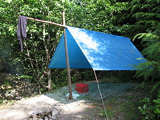 Fly (tent) outer layer of a tent or piece of material which is strung up using rope as a minimalist, stand-alone shelter