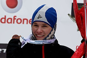 Tatiana Vlasova with bronze medal (long distance at Ski-EOC 2010).jpg