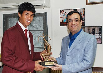 Somdev Devvarman - The Minister of State (Independent Charge) for Youth Affairs and Sports, Ajay Maken presenting the Arjuna Award for the year 2011 to Somdev Kishore Devvarman, in New Delhi on September 20, 2011
