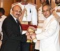 The President, Shri Pranab Mukherjee presenting the Padma Shri Award to Dr. Praveen Chandra, at a Civil Investiture Ceremony, at Rashtrapati Bhavan, in New Delhi on March 28, 2016.jpg
