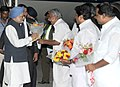 The Prime Minister, Dr. Manmohan Singh being received by the Chief Minister of Kerala, Shri Oommen Chandy, on his arrival at Thiruvananthapuram Airport, in Kerala on January 03, 2014.jpg