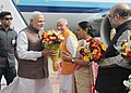 The Prime Minister, Shri Narendra Modi being received by the Governor of Gujarat, Shri O.P. Kohli and the Chief Minister of Gujarat, Smt. Anandiben Patel on his arrival at Ahmadabad airport, in Gujarat on September 16, 2014.jpg