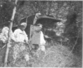 The Woman Citizen 1918 June - Unbroken underbrush surrounding the Labouheyre barracks. German prisoners are carrying in the cook-stove.png
