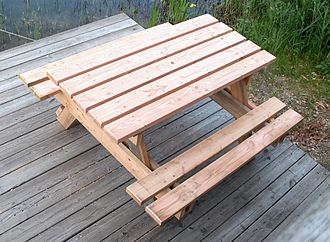 Table (furniture) - A combination of a table with two benches (picnic table) as often seen at camping sites and other outdoor facilities