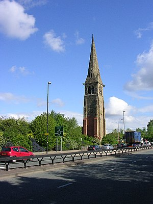 Hugh Stowell - Trafford Road, Salford, with the tower and spire of the former Stowell Memorial Church; the church commemorated the life and work of Canon Hugh Stowell; it was built in 1869 and demolished in 1981