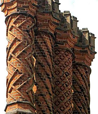 Decorative Tudor brick chimneys at Hampton Court Palace Tudor chimneys on Hampton Court Palace, Middlesex.jpg