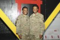 U.S. Army Cpl. Victoria P. Stokes, right, a human resource specialist with Task Force Lifeliner, and her sister Spc. Alisa M. Matthews, a geospatial engineer with Combined Joint Intelligence, pose for a photo 130612-A-ZT122-006.jpg