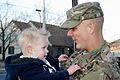 U.S. Army Sgt. Harry May, with the 198th Expeditionary Signal Battalion, Delaware Army National Guard, holds his son in Georgetown, Del., Feb. 26, 2014, after returning from a deployment 140226-Z-ZB970-045.jpg