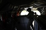 U.S. Army Sgt. Michael Backowski, foreground, a crew chief with Bravo Company, 5th Battalion, 159th Aviation Regiment, pushes a pallet of medical supplies off a CH-47 Chinook helicopter at Camp Atterbury 130813-F-QA406-202.jpg