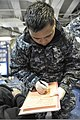 U.S. Navy Hospital Corpsman 3rd Class Joel Escalona records a simulated patient's information during a mass casualty drill aboard the aircraft carrier USS Nimitz (CVN 68) 130111-N-HN953-018.jpg