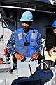 U.S. Navy Mineman 2nd Class Troy Johnson, assigned to MCM Crew Dominant and deployed aboard the mine countermeasures ship USS Gladiator (MCM 11), operates the remote control of an upgraded SeaFox portable mine 130117-N-CG436-115.jpg