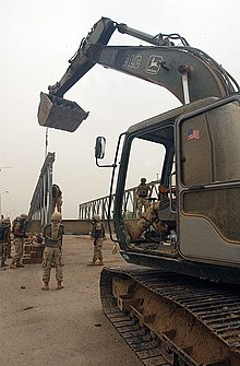 U.S. Navy Seabees attached to Naval Mobile Construction Battalion 133 rebuild Sarabadi Bridge